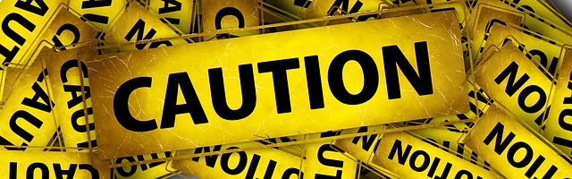 Image of a caution banner. Are your truly risk free?